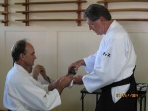 Curtis Sensei pouring Omiki for Senior Instructor Jeff Baldwin